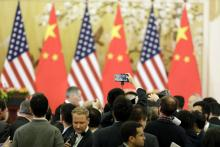 Media wait for President Donald Trump and China's president Xi Jinping to arrive for a news conference in Beijing, China.