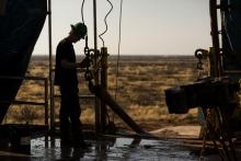 An oil rig worker in the Permian basin outside of Midland, Texas.