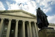 A statue of Albert Gallatin stands outside the U.S. Treasury Building in Washington, D.C.
