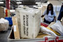 A mail crate sits in a package bin at the United States Postal Service in Washington, D.C.