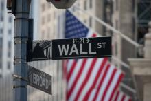 A Wall Street sign is displayed in New York City.
