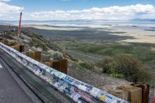 A guardrail covered in bumper stickers along U.S. Highway 395 at Conway Summit in Mono County, CA.