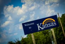 """""""Welcome to Kansas"""" road sign."""