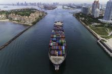 A cargo ship leaves the Port of Miami
