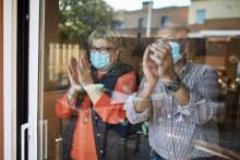 Elderly couple wearing masks.