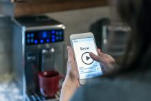 Human Hand Using Application on Mobile Phone, Smart Homes