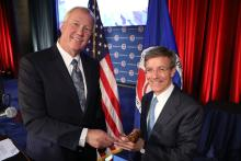 John Hopkins (left), CEO of NuScale Power and past U.S. Chamber chairman passes the gavel to the new chairman, Tom Wilson, chairman and CEO of Allstate.