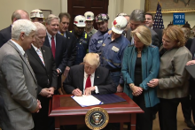 President Donald Trump signs a Congressional Review Act resolution rescinding the Interior Department's Stream Protection Rule.