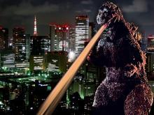 Godzilla destroying a city.