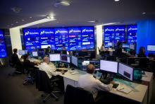 Analysts monitor data at the Market Intelligence Desk (MID) inside the Nasdaq MarketSite in New York.