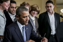 President Barack Obama signed an order to revise overtime rules in 2014.