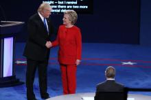 Donald Trump and Hillary Clinton shake hands at the first presidential debate at Hofstra University.