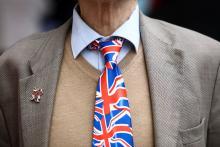 A man wearing a Union Jack tie in London.