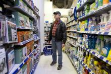 A shopper walks through a Walgreens store in New York.
