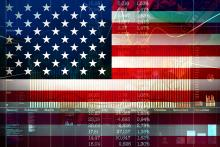 American flag superimposed on economic and financial charts.