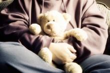 Boy holding a teddy bear.