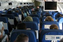 Passengers sitting in airline seats.