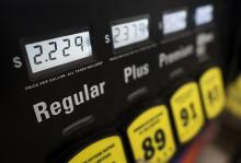 Gas prices reflected at a gas pump
