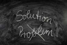 """""""Problem"""" and """"solution"""" written on a chalkboard"""