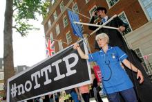 Transatlantic Trade and Investment Partnership (TTIP) protesters in London. Photograph: World Development Movement.