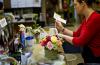 Employee Amy Merritt prepares a flower arrangement at Flowers By Julia in Princeton, Illinois.