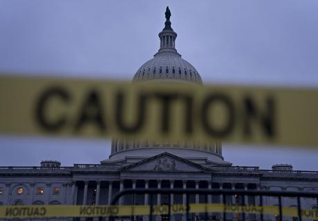 """The U.S. Capitol stands past """"Caution"""" tape in Washington, D.C., U.S., on Thursday, Dec. 20, 2018."""