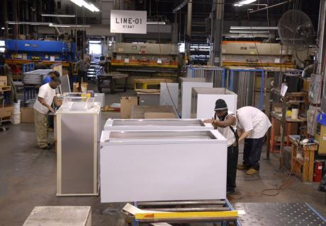 Workers assemble refrigeration units at Victory Refrigeration in Cherry Hill, NJ.