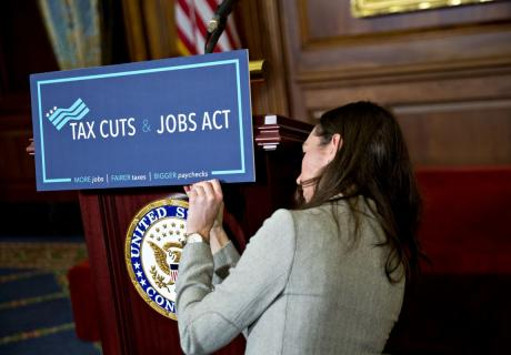 """A """"Tax Cuts and Jobs Act"""" sign on a podium at a news conference after the House of Representatives voted on the tax reform bill in 2017."""