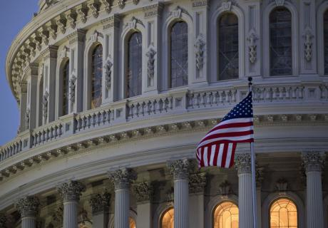 The American flag flies outside the U.S. Capitol.