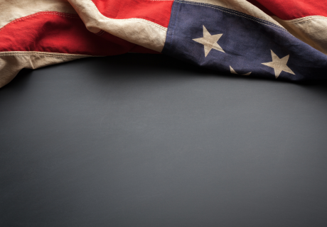 United States flag on a gray background.