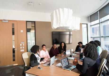 African American women sitting around a table during a business meeting.