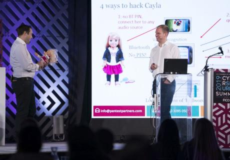 Internet security experts from Pen Test Partners show how a doll can be hacked at the 8th Annual Cybersecurity Summit.
