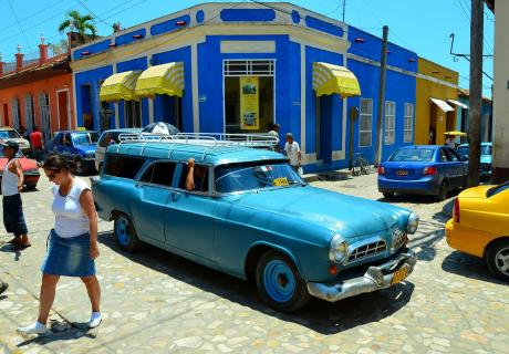A blue station wagon driving the streets of Trinidad, Cuba.