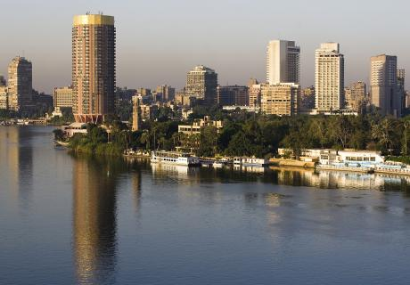 High-rise buildings soar above the Nile River running through Cairo, Egypt.