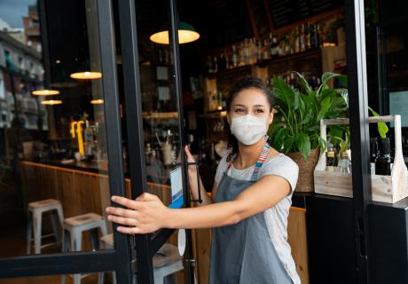 Female business owner wearing mask