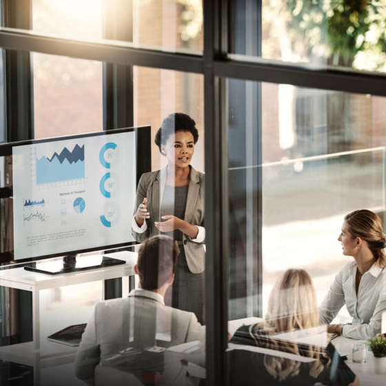 Woman leading meeting with charts