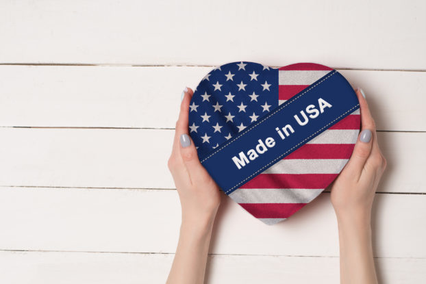 hands holding american flag heart