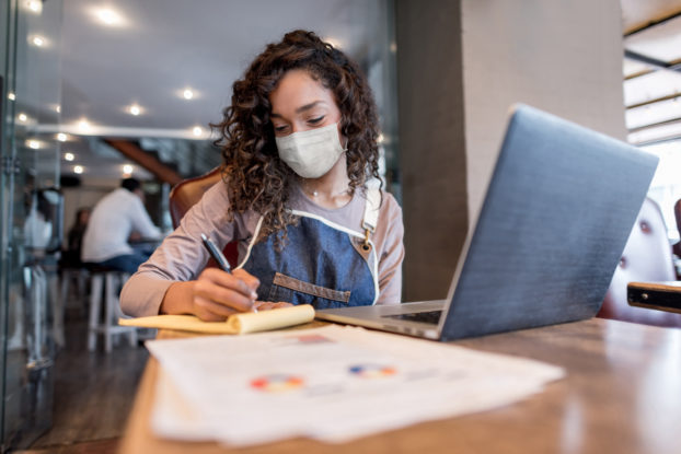 woman doing business with mask on