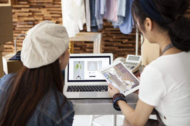 Business owners create an online shop