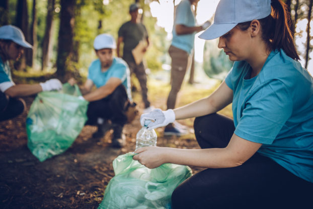 People working together to clean up the environment