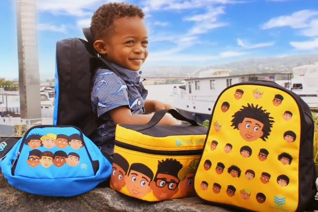little boy sitting with backpacks and accessories created by EPIC Everyday, Inc.