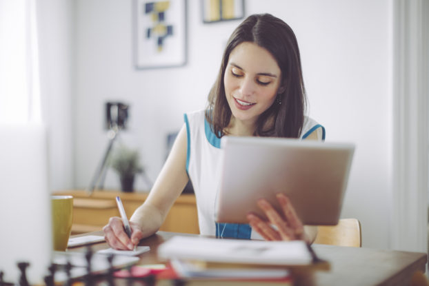 A young woman works remotely.