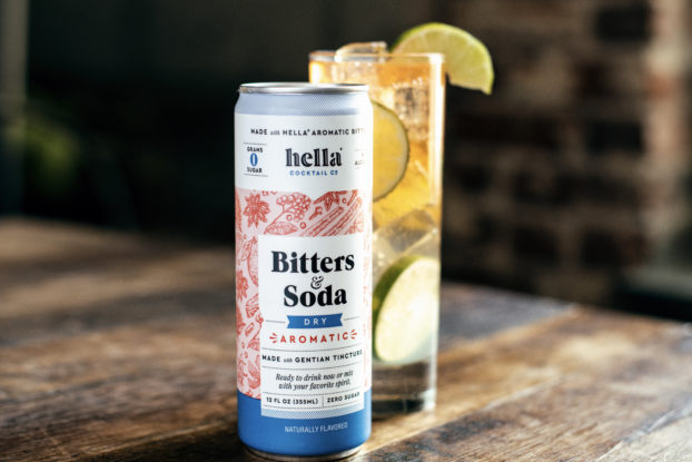 a bitters & soda can with a drink on display by Hella Cocktail Co.