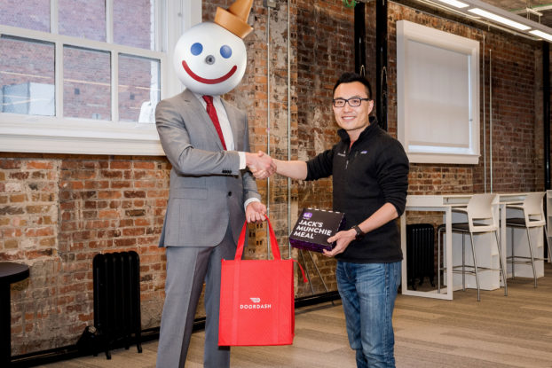 Jack in the Box with Door Dash co-founder and CEO Tony Xu. Jack in the Box uses text messaging to drive delivery orders via Door Dash.
