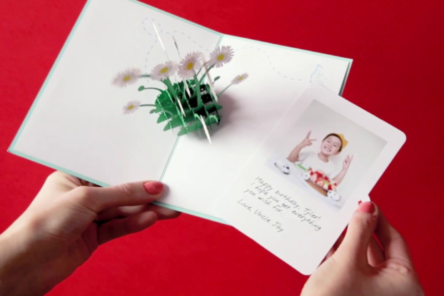 Person opening a greeting card from Lovepop.