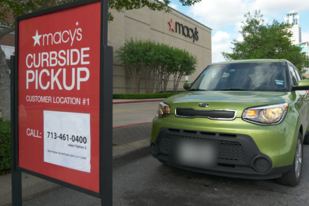 macy's curbside pickup sign with car parked