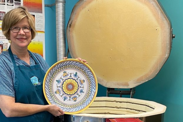 Susan Snyder of Pottery House holding bowl