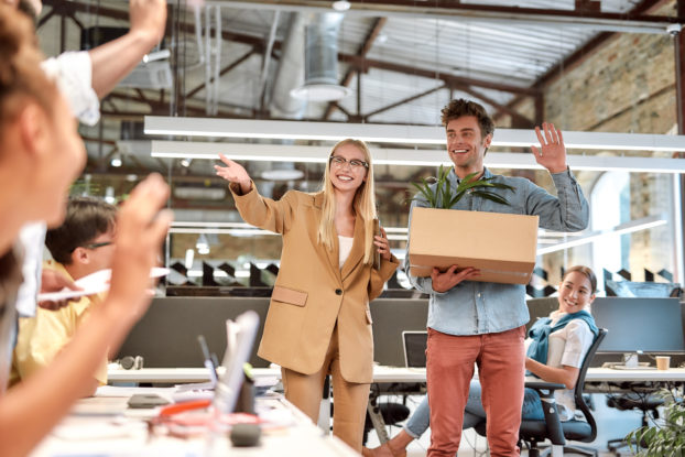 Businesswoman introduces employees to newly hired staff