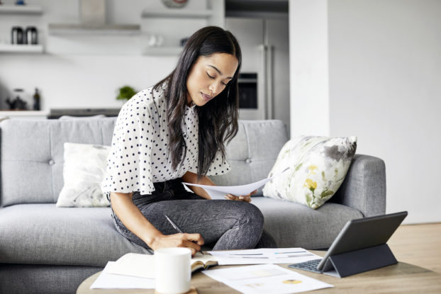 Small business owner reviews finances and considers investment.