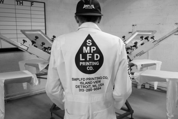SMPLFD founder wearing his printing uniform inside the workplace.